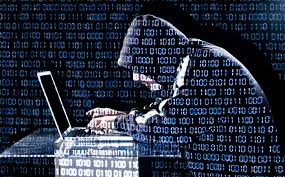 hacker typing on laptop with binary code in background